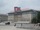 [Building with DPRK flag]